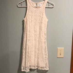 White sleeveless tribal lace dress